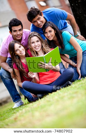 Group of students with a notebook outdoors