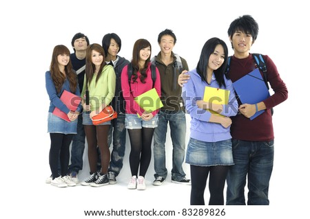 Group Of students with notebooks and paper folders posing--focus on couple standing young Friend - stock photo