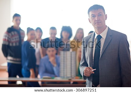 group of students with teacher on class learning lessons - stock photo