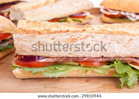 group of sub sandwiches on a table - stock photo