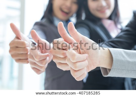 Group of success business people team show thumb up in office, asian