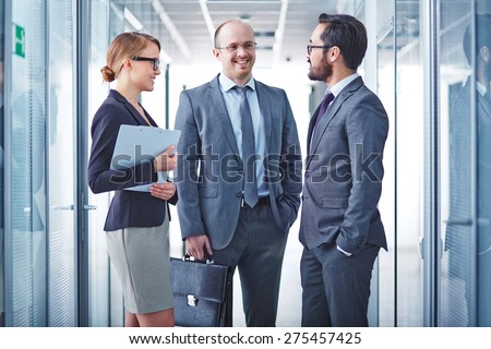 Group of successful business partners having meeting - stock photo
