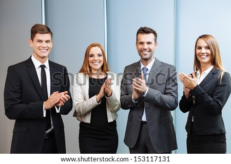 Group of successful business people clapping their hands - stock photo