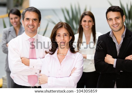 Group of successful business people looking confident - stock photo