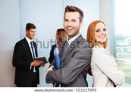 Group of successful business people with leaders in foreground - stock photo