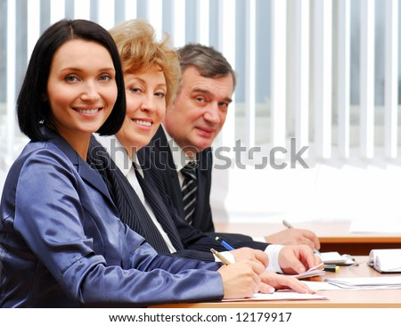 Group of  successful business people working in the office - stock photo