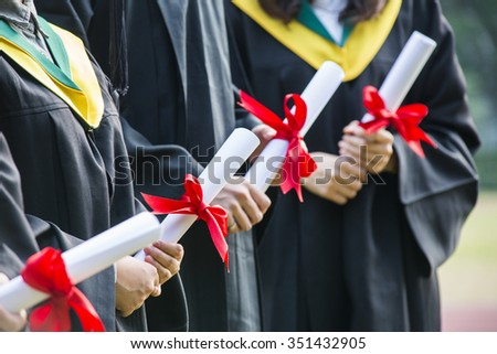 Group of successful students on their graduation day - stock photo