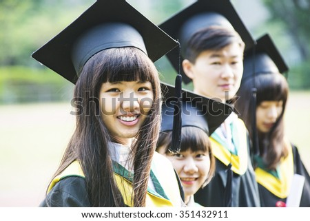 Group of successful students on their graduation day