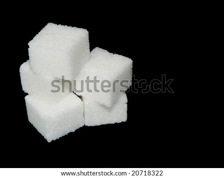 group of sugar cubes on black background - stock photo