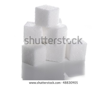 group of sugar cubes on the white background - stock photo
