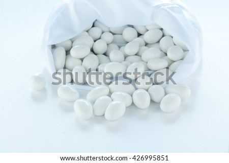 group of sugared almonds on white background,candies
