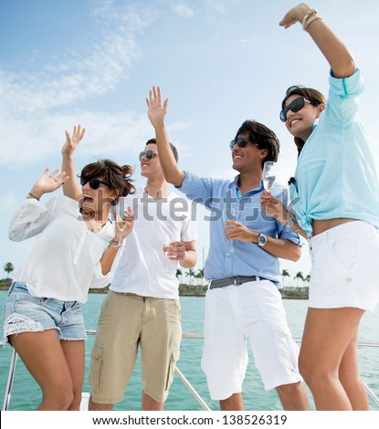 Group of summer people having fun on a boat - stock photo