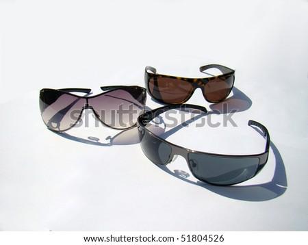 Group of sunglasses on white background - stock photo