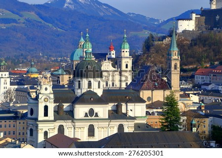 Group of sunny churches surrounded by nearby hills in Salzburg old town, Austria - stock photo