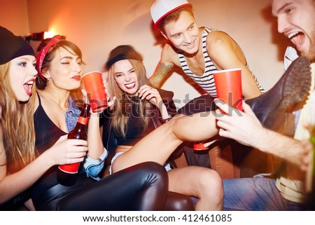 Group of swag people relaxing in night club - stock photo