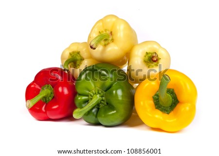 Group of sweet bell peppers isolated on plain white background.