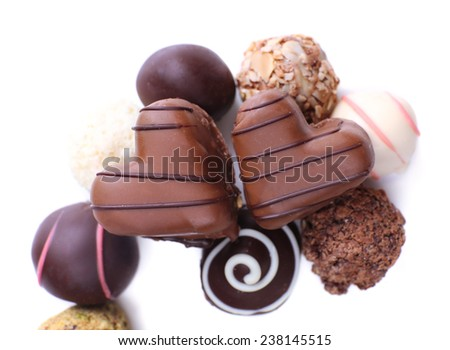 Group of sweet chocolate candies isolated on white background - stock photo