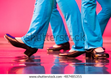 group of tap dancers feet on a shiny stage