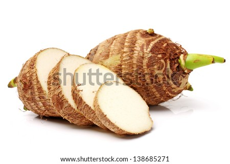 Group of taro roots with one cut in cross sections - stock photo