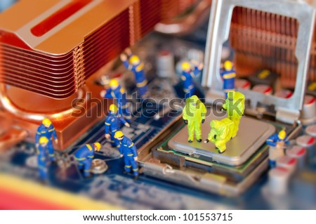 Group of Technicians repairing computer - stock photo