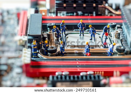 Group of Technicians repairing CPU. Technology concept. Macro photo - stock photo