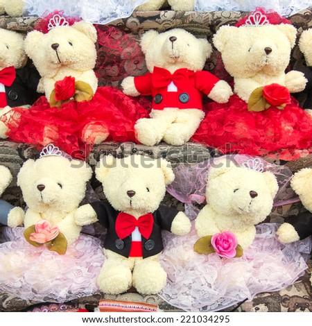 group of teddy bear on shelf in funfair - stock photo
