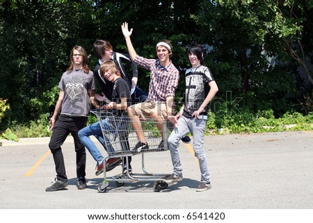 Group of teen boys with a shopping cart