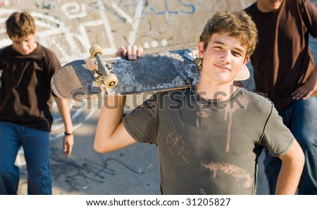 group of teen boys with skateboard on playground - stock photo