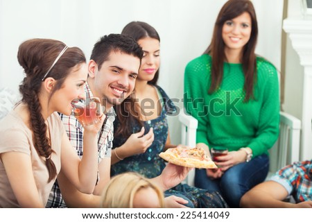 Group of teen friends having a dinner at home - stock photo