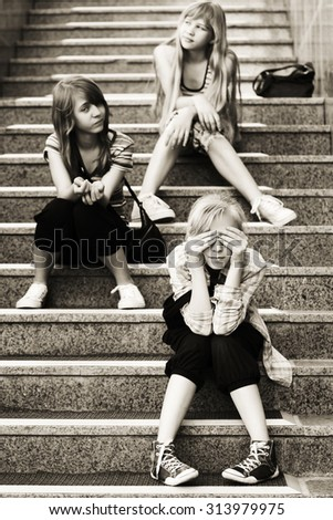 Group of teen girls sitting on the steps - stock photo