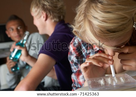 Group Of Teenage Boys And Girls Taking Drugs At Home - stock photo