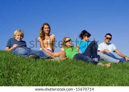 group of teenage friends hanging out - stock photo