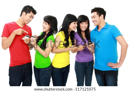 Group of Teenage Friends hold their mobile phones - stock photo