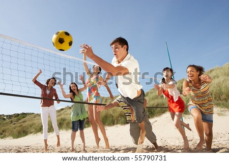 Group Of Teenage Friends Playing Volleyball On Beach