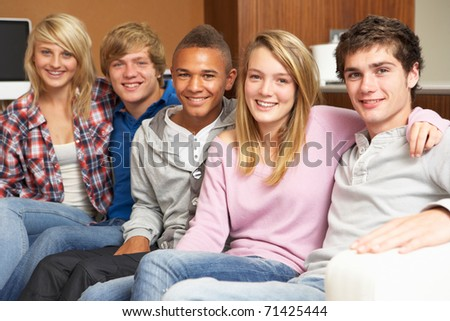 Group Of Teenage Friends Sitting On Sofa At Home - stock photo