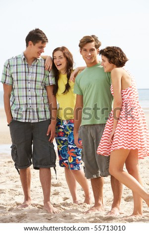 Group Of Teenage Friends Together On Beach - stock photo