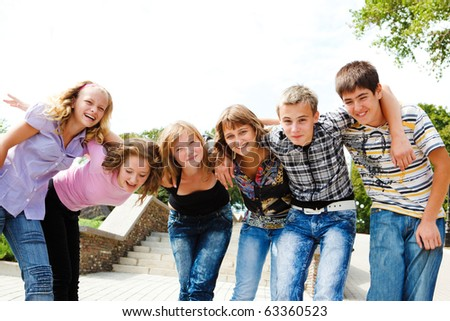 Group of teenage girls and guys - stock photo