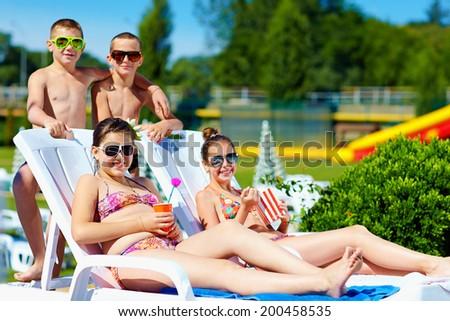 group of teenage kids enjoying summer in water park - stock photo