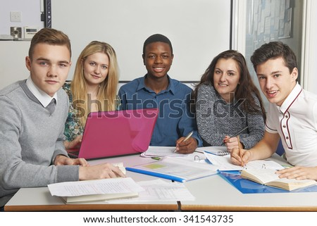Group Of Teenage Pupils Working Together In Classroom - stock photo
