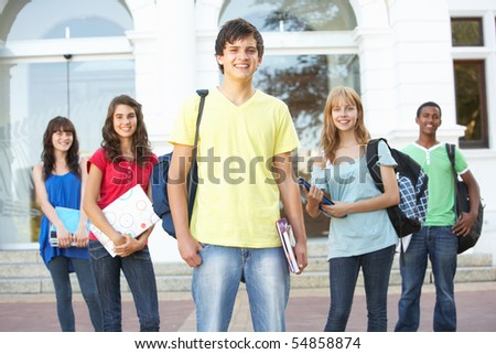 Group Of Teenage Students Standing Outside College Building - stock photo