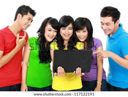 Group of Teenager Friends one of them hold laptop