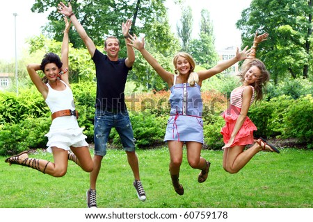 group of teenagers boys and girls in the park - stock photo