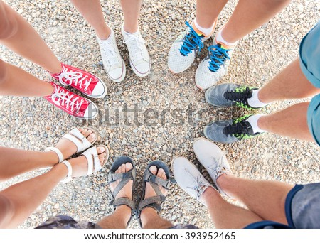 group of teenagers feet in circle - stock photo