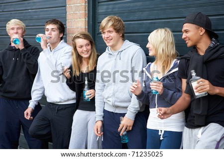 Group Of Teenagers Hanging Out Together Outside Drinking - stock photo