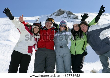 Group of teenagers in snow - stock photo