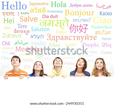 Group of teenagers over the background with the many words from the different languages (language school concept) - stock photo