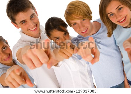 group of teenagers pointing - stock photo
