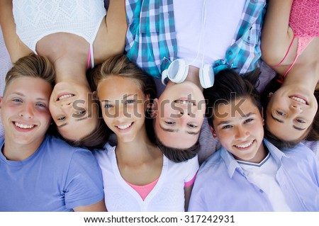 group of teenagers spending time together - stock photo