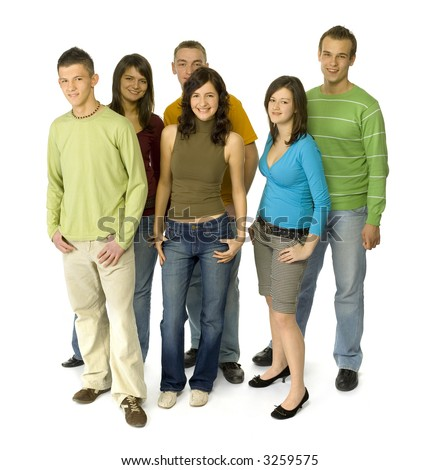 Group of 6 teenagers. They're standing and looking at camera. White background. Whole bodies visible.