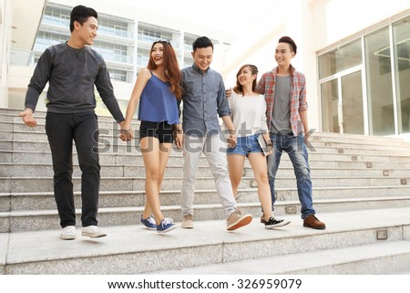 Group of teenagers walking together from school